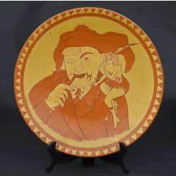 Keramikas šķīvis ar figurālu sižetu